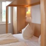 Dreibettzimmer mit Hochbett